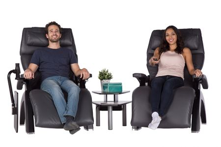 Couple in two Perfect Chairs complemented by PC Media Table