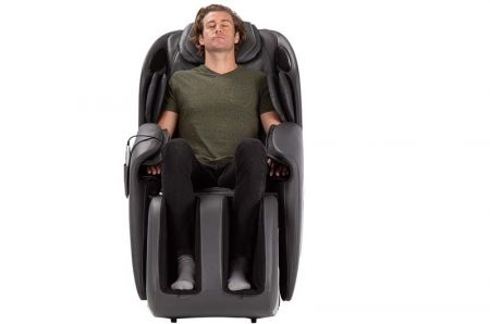 Sana Massage Chair in Gray - Front View with a Person