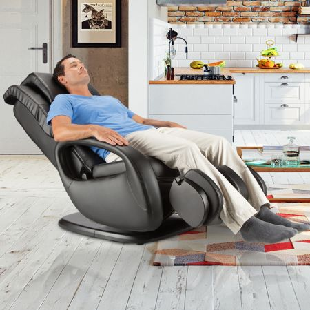 WholeBody 7.1 massage chair in Black upholstery - Man in chair in a room setting