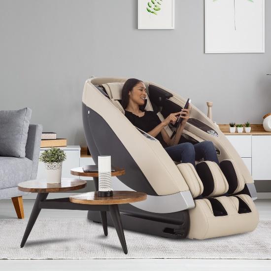 Woman in a Super Novo Massage Chair, using the remote control