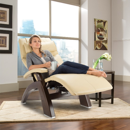 Woman relaxing in a Perfect Chair zero gravity recliner