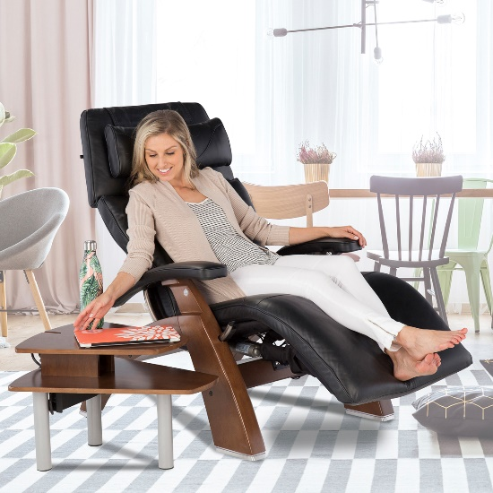 Woman in a Perfect Chair reaching for her laptop